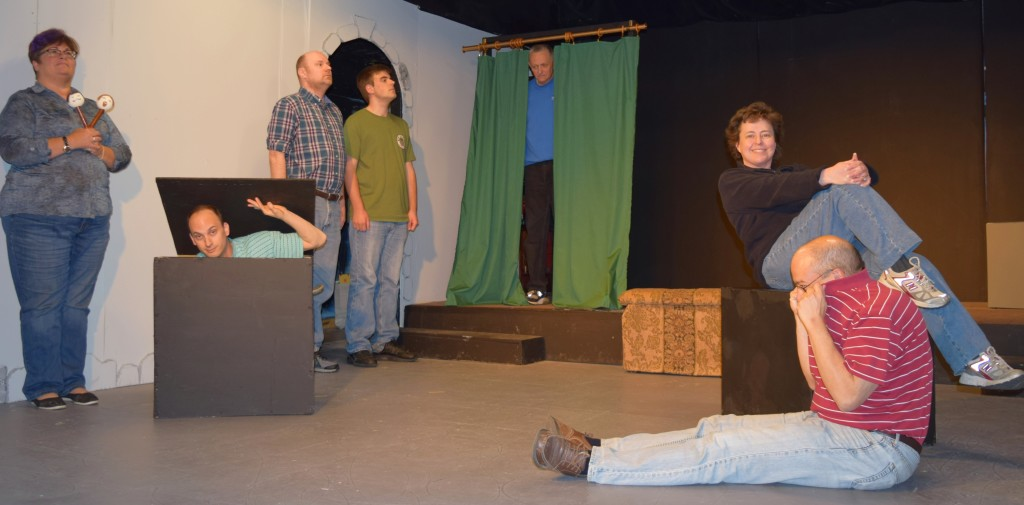 """Clarkston Village Players, from left,  Karen McClellan, Robert Falquet, Todd St. George, Eric Easterday, Jim Pike, Beth Egan DeGuise, and Phil Custodio rehearse for their May show """"Hamlet II."""" Photo provided"""