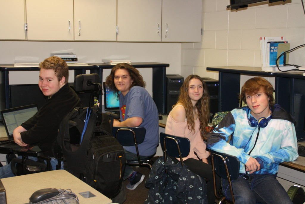 Clarkston High School seniors, from left, Reilly Parent, Devin Radzwion, Kate Campbell, and Gavin Slater, in their AP Computer Science class. Photo by Jessica Steeley