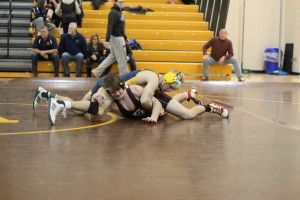 Jake Billette gets a hold of Birmingham Seaholm. Photo by Wendi Reardon Price