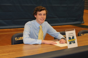 Jake Dolan signs to run for the University of Michigan - Dearborn, Feb. 8. Photo by Wendi Reardon Price