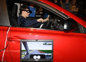 Sophomore Joshua Luther drives through the simulation, the screen shows what he sees
