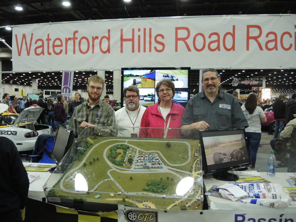 From left, Todd Geiser, Chip Bliem, Kay Bliem, and Ed Frank of Waterford Hills Road Race track in Independence Township set up shop at Autorama to talk cars and racing.