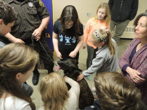 The students get a chance to pet Diago, a K9 police dog. He was at the Optimist Club meeting with his partner, Deputy Rodney White. Photo by Phil Custodio
