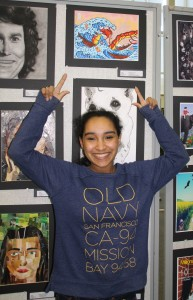 Daejah Sotelo, senior, pointing to her piece