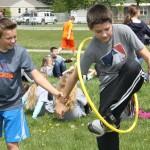 Jake Campbell and Zach Scherler passing a hoop