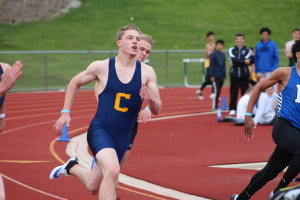 Max Salter runs in the 200-meter dash during preliminary race at the OAA Red league meet. Photo by Wendi Reardon Price