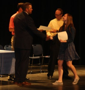 Danielle Little, 3.96 honor roll shaking hands with CJHS principal Adam Kern