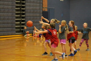 Young campers go after the ball in a game of basketball last Thursday during Dare to Dream. Photo by Wendi Reardon Price
