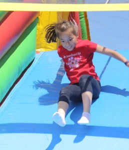 Katelynn Suida sliding down the inflatable structure