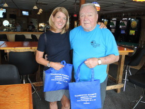 Aimee Baker, SCAMP executive director, and longtime SCAMP volunteer John Spokaeski are hard at work, organizing the annual picnic at Independence Oaks. Photo by Phil Custodio