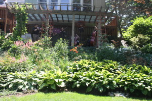 Musicians playing in Patti Gilman's garden, featured on the Clarkston Garden Walk. Photo by Jessica Steeley