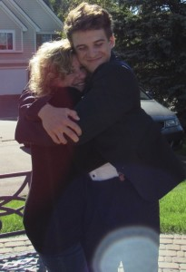 Jake Billette gives his mother, Linda, a big hug. He will play for her during Football for a Cure, Sept. 8. Photo provided