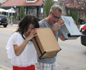 Stephanie Tran and Scott Stanley look at Monday's eclipse through box viewers. Photo by Jessica Steeley