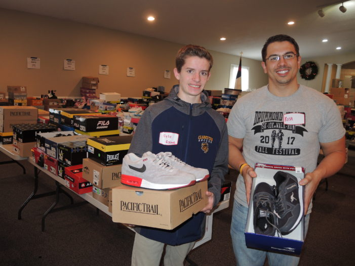 Volunteers fill church for Shoes