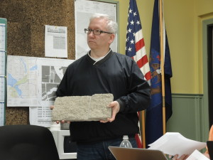 Clarkston City Council member Al Avery displays material proposed for the DPW, city hall expansion project. Photo by Phil Custodio