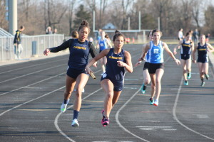 Kayla Russell hands the baton to Makayla Owens in the 400-meter relay. Photo by Wendi Reardon