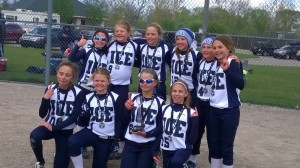 The ICE Fastpitch 10U Blue team celebrates their first place finish. Photo submitted