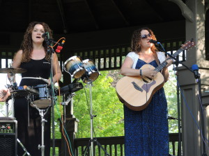 The Mickeys singers Amy Sherman, playing percussion, and Julie Peebles on guitar perform in the Depot Park gazebo. Photos by Phil Custodio