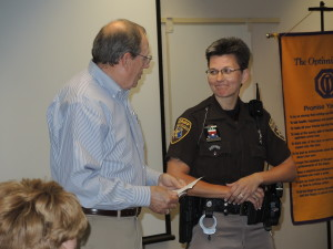 Optimist Dennis Ritter persents Deputy Sharon Beltz with Deputy of the Year honors. Photo by Phil Custodio