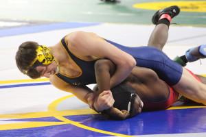 Nathan Vandermeer wrestles at the state finals. Photo by Wendi Reardon
