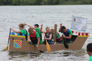 Team 8, sponsored by The Clarkston News, paddles to first during the final race. Photo by Wendi Reardon