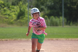 Anna Voto runs to third base during the last scrimmage.