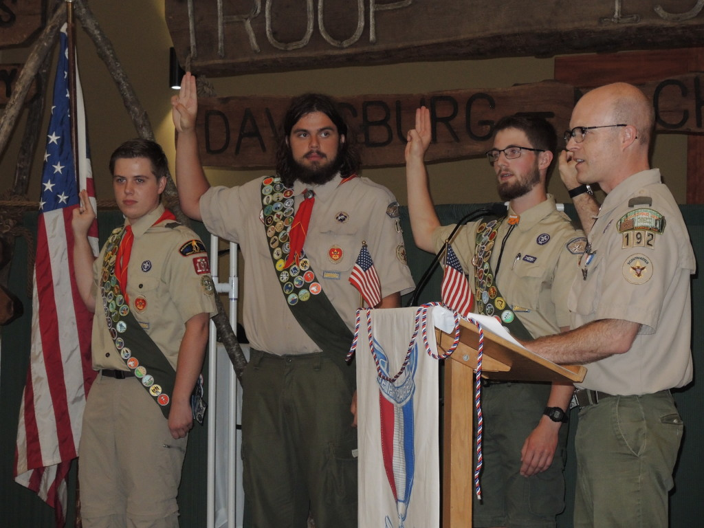 Troop 192 Boy Scouts Brandon C. Graham, Dawson L. Holloway, and Isaac J. Ekstrom take the Eagle Charge and Promise, with Scoutmaster Lee Ekstrom, at their Eagle Scout Court of Honor, Aug. 13. Photo by Phil Custodio