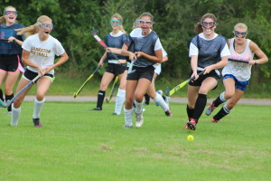 The Lady Wolves run after the ball during their field hockey scrimmage last Thursday. Photo by Wendi Reardon Price