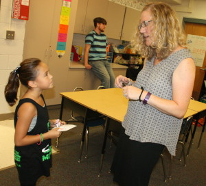 Alejandra Reyes talks about the upcoming school year with third grade teacher Kara Lomazov. Photos by Trevor Keiser.