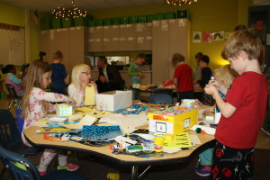 """Ms. Mitchell's Kindergarten students build and decorate boxes during """"purposeful play"""" time. Photo by Jessica Steeley"""