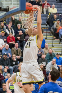 Dylan Alderson dunks a basket during the Wolves' win over Walled Lake Western. Photo by Larry Wright