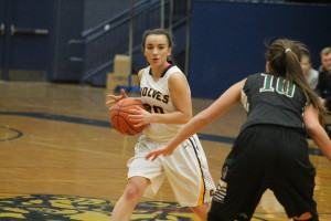 Lady Wolves point guard Kiana Ayotte looks for ways to shut down Lake Orion, Dec. 16. Photo by Wendi Reardon Price