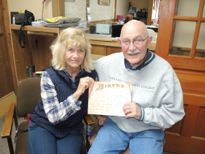 Sally Hadden, with Clarkston genealogist Tom Stone, knows much family history thanks to an old family Bible.