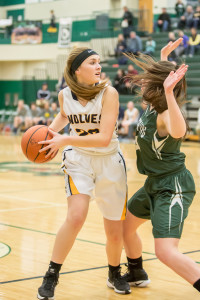 Freshman Taylor Heaton eyes an open teammate during the first half. Photo by Larry Wright