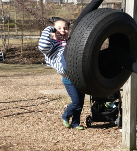 Emma Albani enjoys the Depot Park tire swing, one of the pieces recommended for replacement. Photo by Jessica Steeley