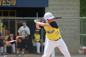 Caden Morello swings against Oxford during the Wolves' home game, May 17. Photo by Wendi Reardon Price