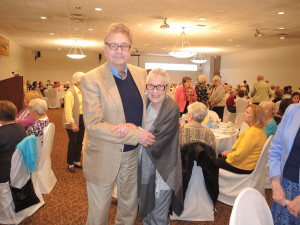 Mary Graybiel with antiques expert Frank Loomis at the May 10 Oakland Town Hall lecture and lunch.