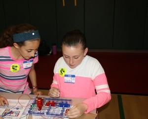 Sara Mansour and Alaina Pruitt putting together a circuit