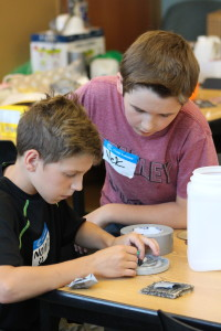 Nolan Rhodes and Nick Blanchard focus on their invention. Photo by Wendi Reardon Price