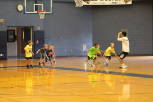 John Chrenka leads campers in a drill during Session Two. Photo by Wendi Reardon Price