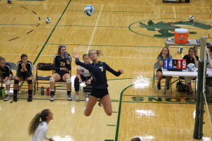 Abbey Malinowski jumps to deliver a powerful hit against Notre Dame Prep, Aug. 22. Photo by Wendi Reardon Price