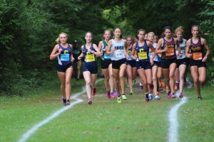 The Lady Wolves keep up with the front runners from Troy and Birmingham Seaholm in the first OAA Red Jamboree for the season. Photo by Wendi Reardon Price