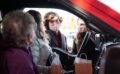 Clarkston grads embrace COVID times with drive-thru wedding shower